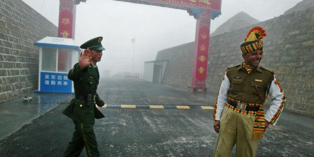 In this photograph taken on July 10, 2008 a Chinese soldier (L) and an Indian soldier stand guard at...