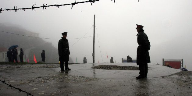 Chinese soldiers guard the Nathu La mountain pass, between Tibet and