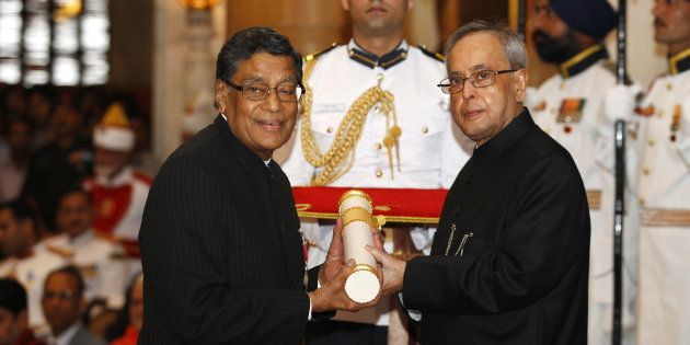 President Pranab Mukherjee presenting the Padma Vibhushan award to senior advocate KK Venugopal during...