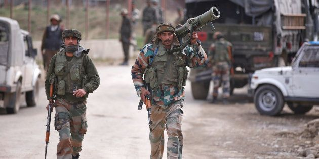 Representative image. Indian army soldiers arrive at the site of a gunbattle with suspected militants...