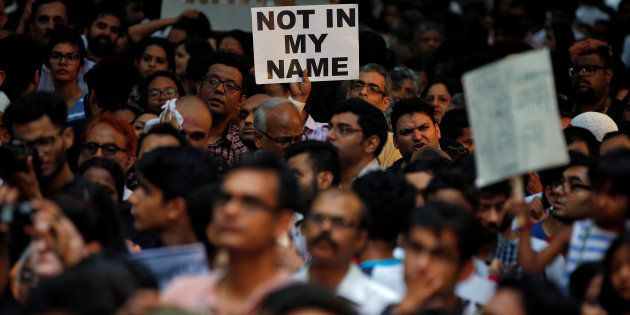 People protest against the recent cases of mob lynching of Muslims who were accused of possessing beef,...