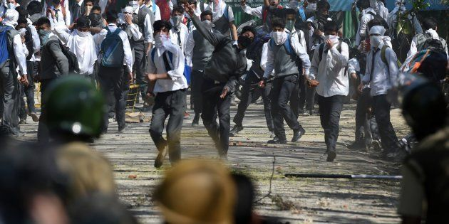 Kashmiri students clash with Indian government forces near a college in central Srinagar's Lal Chowk...