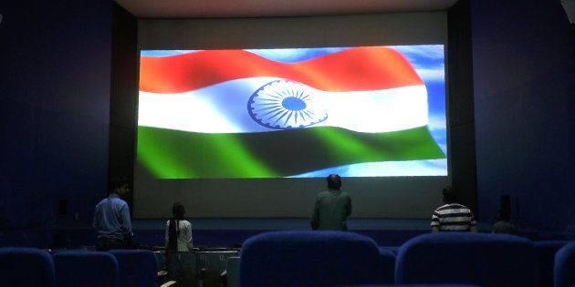 This picture taken on March 17, 2017 shows audience members standing for the Indian national anthem before...