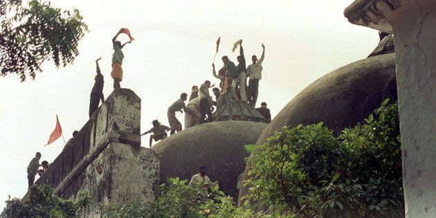AYODHYA, INDIA - DECEMBER 6: Hindu fundamentalists celebrate atop the 16th century Babri Masjid (mosque)...