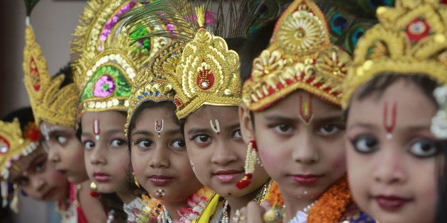 Schoolchildren dressed as Hindu Lord Krishna, wait to perform during the celebrations to mark the Janmashtami...