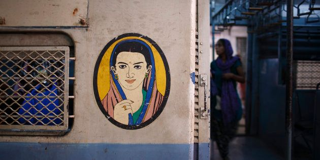 A portrait of a woman is seen near the entrance of the female compartment of a suburban train at Chhatrapati...