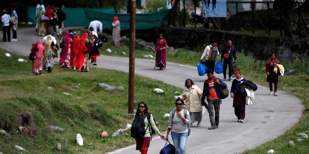 Hindu pilgrims arrive after visiting the Amarnath cave shrine where they worship an ice stalagmite that...