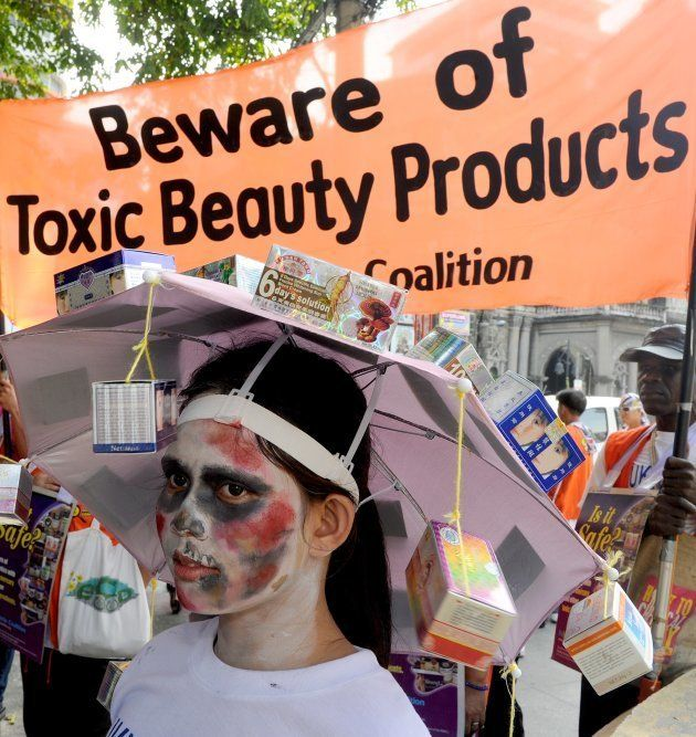 Philippine environmental activists march on Manila's Chinatown August 10, 2011 to demand that shops stop...