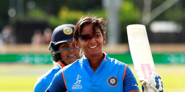 India's Harmanpreet Kaur walks off after scoring 171 not