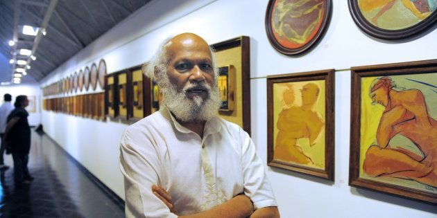 Indian artist Jatin Das poses at an art exhibition in