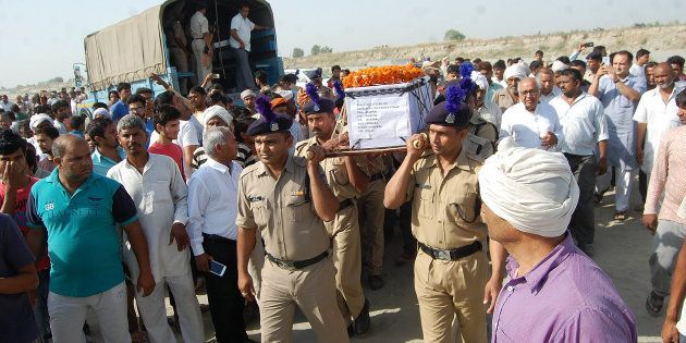 Sukma Martyr CRPF ASI Naresh Kumar's terrestrial body carried by CRPF personnel at his native village...