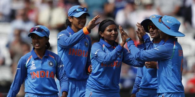 India's Rajeshwari Gayakwad (C) celebrates with teammates after taking the wicket of England's Lauren...