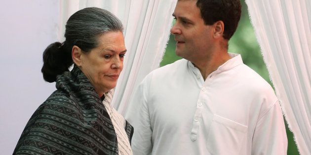 India's main opposition Congress party president Sonia Gandhi (L) and her son and the party's vice-president...