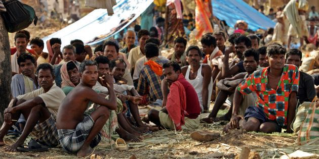 Tribal people sit at a relief camp in Dharbaguda, in the central state of Chhattisgarh, March 8, 2006....