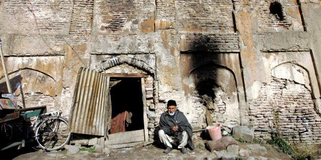 Representative image. Sikander Shah,70, a Kashmiri man, sits at the entrance of his house inside the...