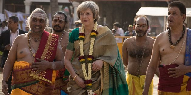 British Prime Minister Theresa May is welcomed to the Sri Someshwara Temple on November 8, 2016 in Bangalore,