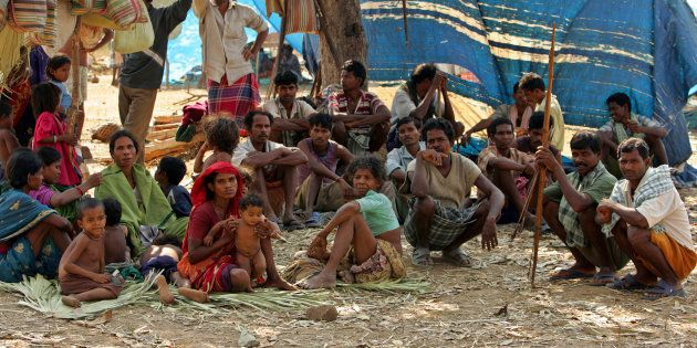 A group of Indian tribe sit in open at a camp in Dornapal in Chhattisgarh, India March 8, 2006. More...