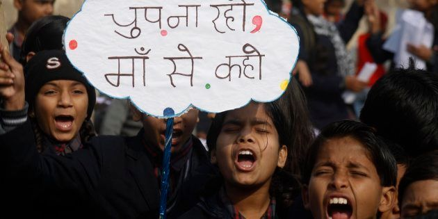 Indian children shouting slogans to create awareness about child sexual abuse in a