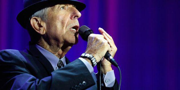 LONDON, ENGLAND - SEPTEMBER 15: Leonard Cohen performs live on stage at O2 Arena on September 15, 2013...