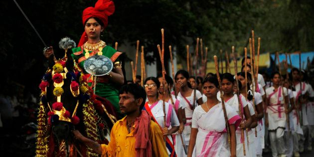 Members of the Rashtra Sevika Samiti participate in a procession in