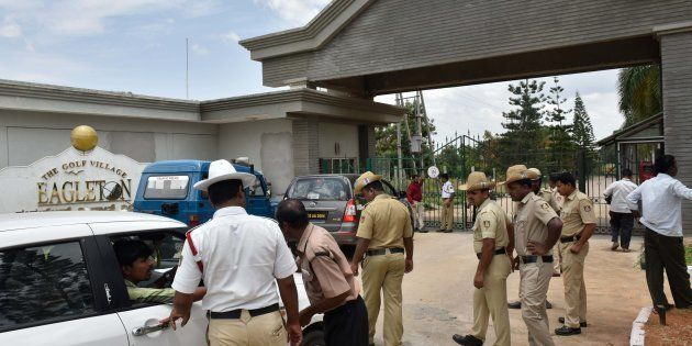 Police frisking cars going inside The Golf Village Eagleton resort as Congress MLAs from Gujarat are...
