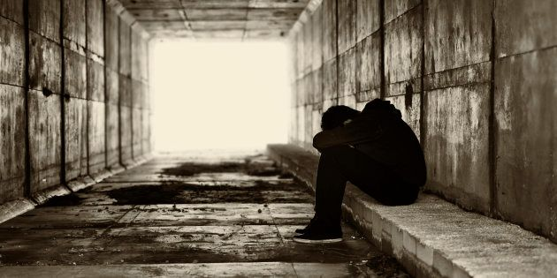 Boy sat in a corridor with the head