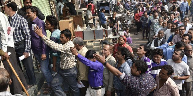 NEW DELHI, INDIA - NOVEMBER 10:  Long queue in front of the Oriental Bank of Commerce near Mahila Colony  Gandhi Nagar east Delhi for new currency  on November 10, 2016 in New Delhi, India. Image used for representational purposes only.
