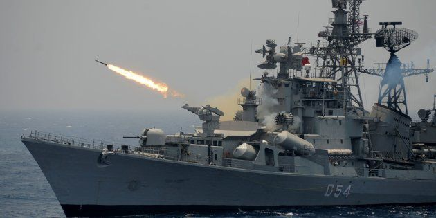 A rocket is fired from the Indian Navy destroyer ship INS Ranvir during an exercise drill in the Bay...
