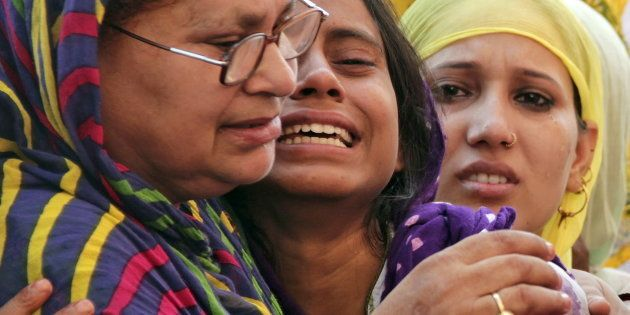 Relatives of Mohammad Akhlaq mourn after he was killed by a mob at his residence in Dadri town, in Uttar