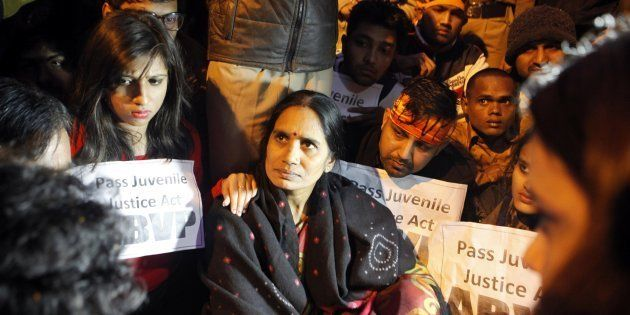 The mother of a Delhi gang-rape victim, named 'Nirbhaya' by the media, attends a rally held to protest...
