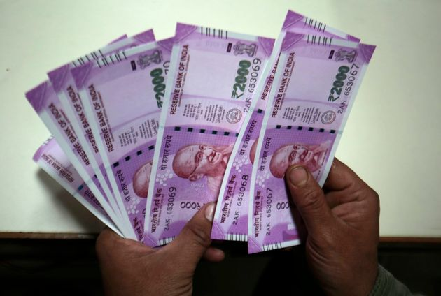 Canadians Stuck With Worthless Cash After India Cancels Rupee