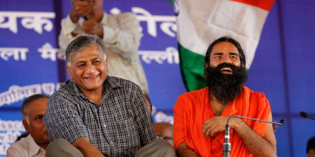 Baba Ramdev, right, seated next to retired former Indian Army chief General V.K. Singh during a protest...