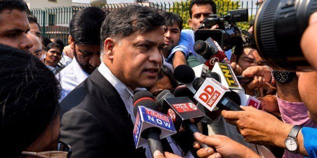 Indian prosecution lawyer Siddharth Luthra (C) addresses media representatives outside The Supreme Court...