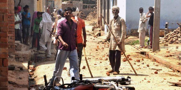 Saharanpur : People near a damaged bike after a clash during a Shobhayatra in Saharanpur on