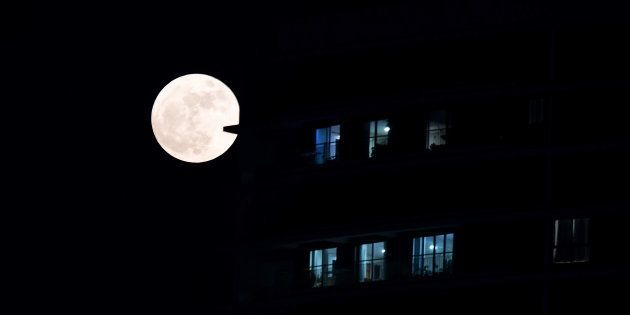 A supermoon rises in front of a high-rise building in Kolkata on November 14,