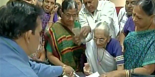 Prime Minister Narendra Modi's mother Heeraben Modi visited a bank in Gandhinagar to exchange old