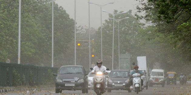 Commuters driving during the dust storm and strong winds, on April 22, 2017 in Chandigarh,