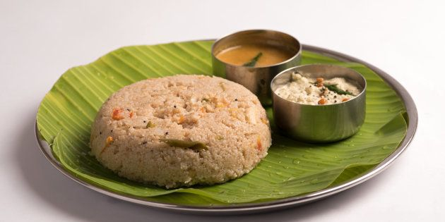 godhuma rava upma with sambar and coconut chutney served in a banana leaf on white