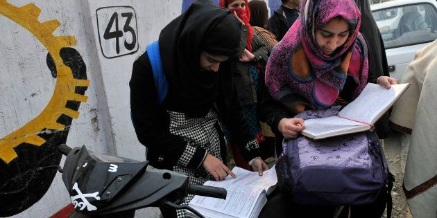 Students revise for the last time before entering exam centre as class 12 state board exams started in...