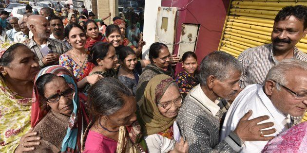 People in queue outside a bank to deposit and exchange 500 and 1000 currency notes at Paharganj, on November...