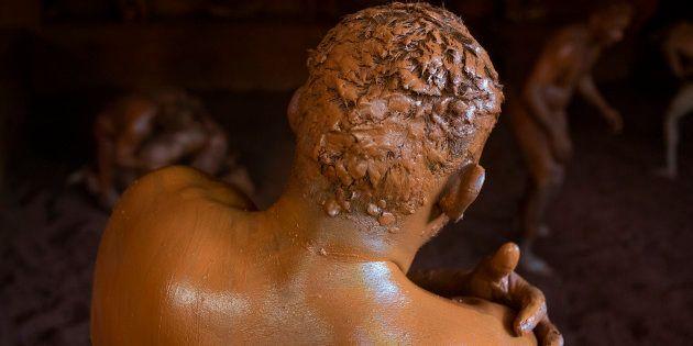 REPRESENTATIVE IMAGE: A wrestler practicing in a mud