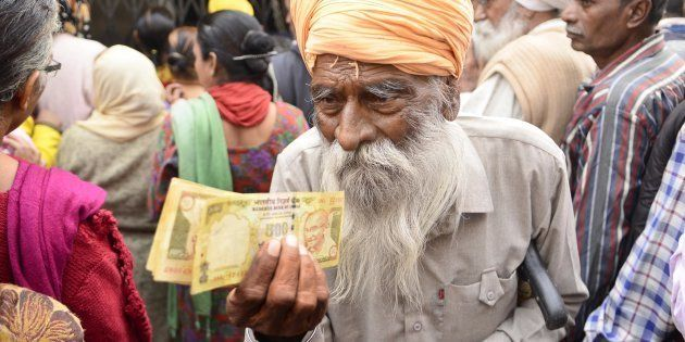 Senior citizens wait to deposit and exchange 500 and 1000 rupee notes in Amritsar, India. (Photo by Sameer...