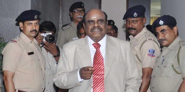 Calcutta High Court judge Justice Chinnaswamy Swaminathan Karnan (C) gestures as he speaks with Indian...