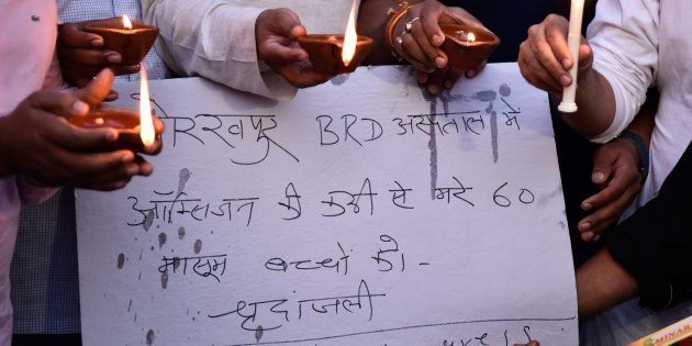 Indian Youth Congress members and activists hold a candle light vigil in memories of the 30 children...