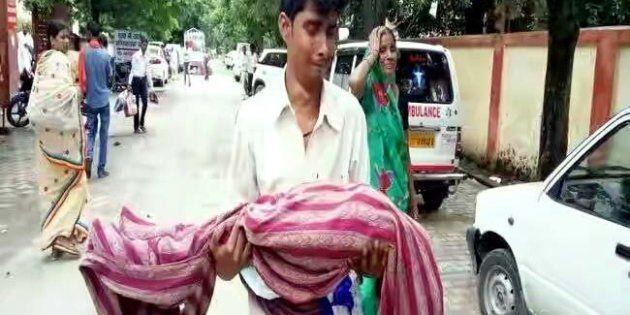 Family member mourn outside Baba Raghav Das Medical Colleges hospital where at least 30 children died...