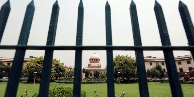 India's Supreme Court is pictured through a gate in New Delhi, India May 26, 2016. REUTERS/Anindito