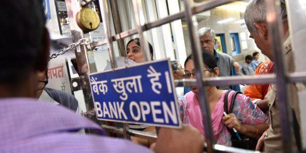 NEW DELHI, INDIA - NOVEMBER 10: Rush at the State Bank of India, Central Market, Lajpat Nagar on the...