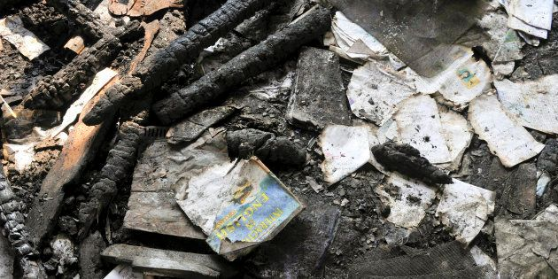 Burnt books inside the gutted building of government school at Gori Pora on October 31, 2016 in Srinagar,