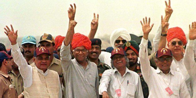 Former Indian Prime Minister Atal Behari Vajpayee (L) with Defence Minister George Fernandes (2nd-L)...