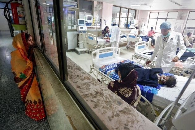 A woman looks into the intensive care unit (ICU) at the Baba Raghav Das hospital in the Gorakhpur district,...